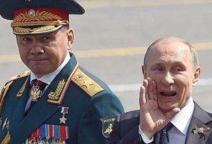 Путин и Шойгу в ожидании парада.